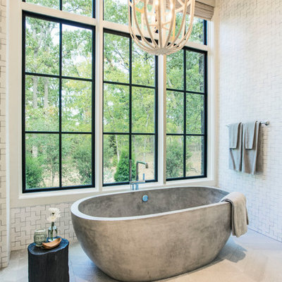 Inspiration for a coastal master white floor freestanding bathtub remodel in Dallas with white walls