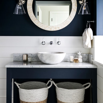 Inspiration for a mid-sized coastal bathroom remodel in London with open cabinets, blue cabinets, blue walls, a vessel sink, gray countertops and marble countertops