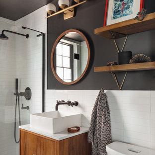 Idee per una stanza da bagno con doccia tradizionale con ante lisce, ante in legno scuro, piastrelle bianche, pareti nere, lavabo a bacinella e top bianco