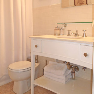 Bathroom - mid-sized transitional white tile and subway tile mosaic tile floor and beige floor bathroom idea in New York with white cabinets and an undermount sink