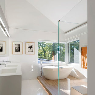 Example of a large trendy master white tile white floor bathroom design in San Francisco with an integrated sink, white cabinets, white walls, flat-panel cabinets and a hinged shower door