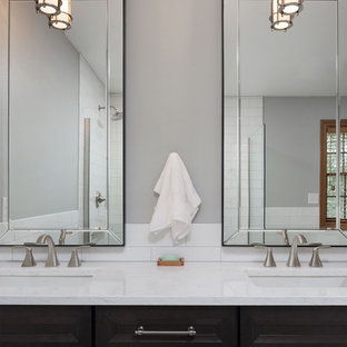 Mid-sized transitional master white tile and ceramic tile mosaic tile floor and white floor bathroom photo with shaker cabinets, dark wood cabinets, a two-piece toilet, gray walls, an undermount sink and marble countertops