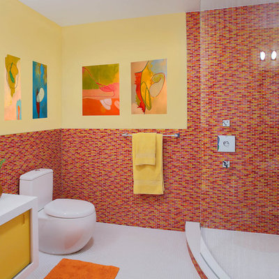 Corner shower - contemporary mosaic tile and red tile corner shower idea in New York with yellow cabinets and red walls