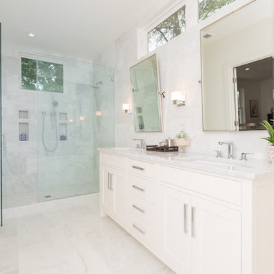 Example of a transitional white tile alcove shower design in DC Metro with an undermount sink, shaker cabinets and white cabinets