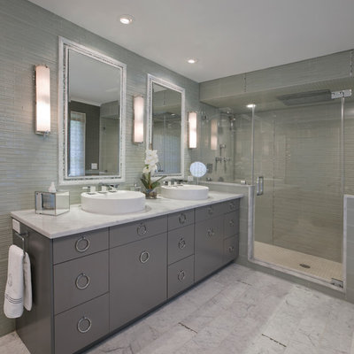 Mid-sized trendy master marble floor and white floor alcove shower photo in New York with a vessel sink, gray cabinets, flat-panel cabinets, a two-piece toilet, gray walls, marble countertops and a hinged shower door