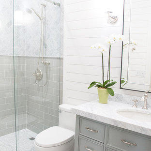 Example of a small transitional 3/4 marble tile and gray tile mosaic tile floor and gray floor bathroom design in Austin with a one-piece toilet, white walls, an undermount sink, marble countertops, furniture-like cabinets and gray cabinets