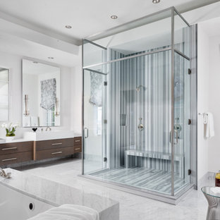 Small trendy master white tile white floor and double-sink bathroom photo in Austin with flat-panel cabinets, brown cabinets, white walls, a drop-in sink, a hinged shower door, white countertops and a built-in vanity