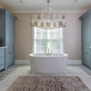 Example of a small classic master multicolored tile and ceramic tile beige floor and porcelain floor bathroom design in Cleveland with blue cabinets, beige walls, an undermount sink, beaded inset cabinets, a one-piece toilet, quartz countertops and a hinged shower door