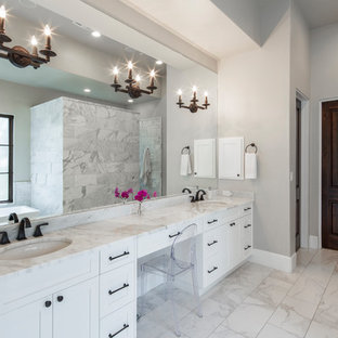 Large tuscan master white tile and marble tile marble floor and white floor bathroom photo in Austin with shaker cabinets, white cabinets, beige walls, an undermount sink and marble countertops