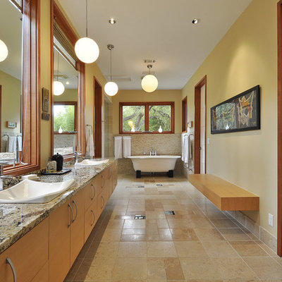 Inspiration for a contemporary freestanding bathtub remodel in Austin with granite countertops and a drop-in sink