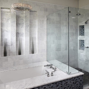 Trendy gray tile corner shower photo in Austin with an undermount tub