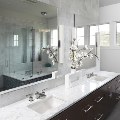 Inspiration for a contemporary bathroom remodel in Austin with marble countertops