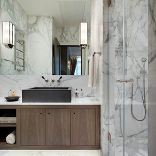 Photo of a medium sized modern ensuite bathroom in London with flat-panel cabinets, brown cabinets, a walk-in shower, grey tiles, white tiles, marble tiles, marble flooring, a vessel sink, marble worktops, white floors and a hinged door.