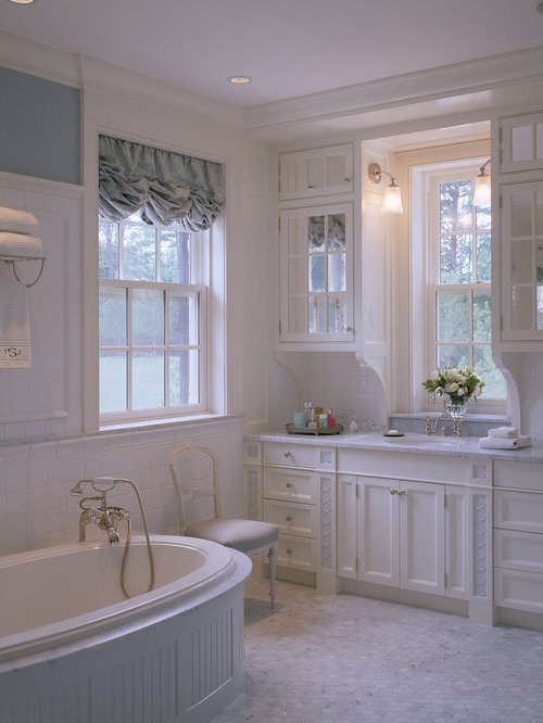 Elegant Alcove Bathtub Photo In Boston With Recessed Panel Cabinets And An  Undermount Sink