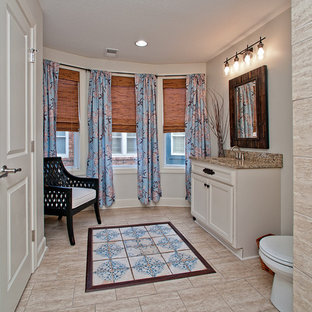 Inspiration for a small eclectic master marble tile ceramic floor and beige floor bathroom remodel in Kansas City with white cabinets, a two-piece toilet, brown walls and granite countertops