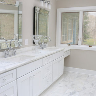 Example of a large classic master white tile and stone tile marble floor bathroom design in New York with an undermount sink, shaker cabinets, white cabinets, marble countertops, a two-piece toilet and beige walls