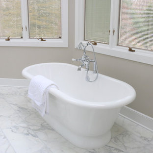 Inspiration for a large timeless master white tile and stone tile marble floor bathroom remodel in New York with an undermount sink, shaker cabinets, white cabinets, marble countertops, a two-piece toilet and beige walls