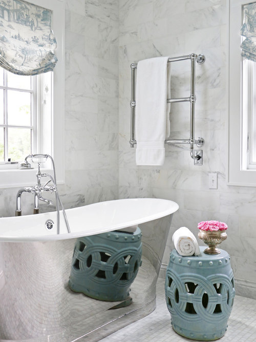 inspiration for a large timeless master marble tile marble floor and white floor freestanding bathtub remodel