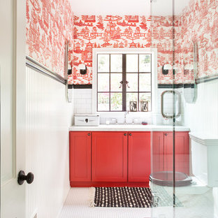 Inspiration for a cottage 3/4 white tile and subway tile mosaic tile floor, white floor, single-sink and wallpaper corner shower remodel in Los Angeles with shaker cabinets, red cabinets, a two-piece toilet, red walls, a hinged shower door, an undermount sink, marble countertops, white countertops and a built-in vanity