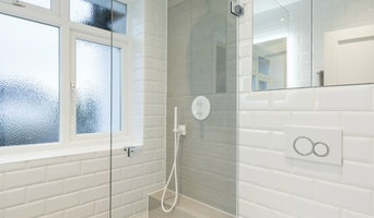 Wet-Room paired with Concrete Tiles and White Metro Subway Brick