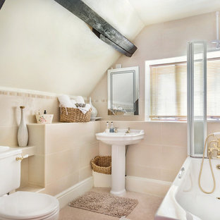 Inspiration for a small rural bathroom in Other with a corner bath, a two-piece toilet, beige tiles, white walls, a console sink, beige floors and an open shower.