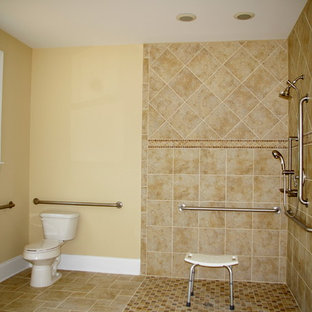 Doorless shower - large traditional master beige tile and ceramic tile ceramic floor doorless shower idea in Raleigh with a one-piece toilet and beige walls