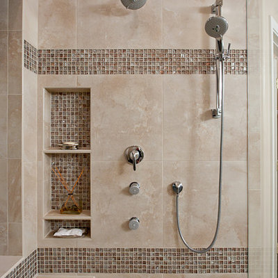 Example of a trendy beige tile and brown tile bathroom design in Phoenix with a niche