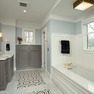 Large elegant master mosaic tile floor and multicolored floor bathroom photo in DC Metro with beaded inset cabinets, gray cabinets, an undermount tub, blue walls, an undermount sink, quartz countertops and white countertops