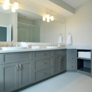 Trendy gray tile bathroom photo in Calgary with a vessel sink, shaker cabinets and gray cabinets