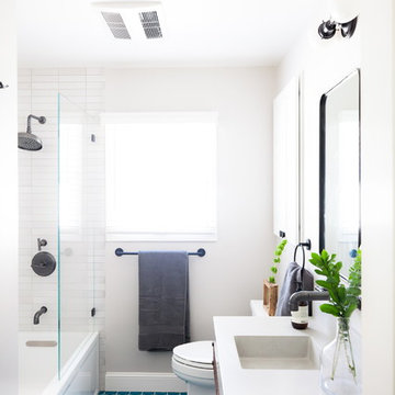 White Bathroom with Bright Blue Hexagon Floor Tiles
