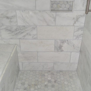 Example of a mid-sized minimalist master gray tile, white tile and porcelain tile marble floor bathroom design in Atlanta with shaker cabinets, black cabinets, a one-piece toilet, gray walls, an undermount sink and solid surface countertops