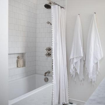 White Ceramic Tile Tub Surround and Hex Tiles