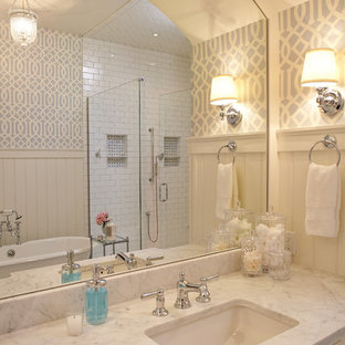 Coastal subway tile bathroom photo in Grand Rapids with marble countertops