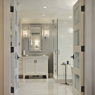 Large elegant master gray tile and stone tile marble floor bathroom photo in Vancouver with recessed-panel cabinets, white cabinets, a two-piece toilet, gray walls, an undermount sink and engineered quartz countertops