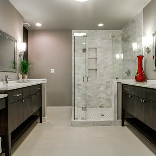 Example of a trendy white tile corner shower design in Dallas with flat-panel cabinets and dark wood cabinets