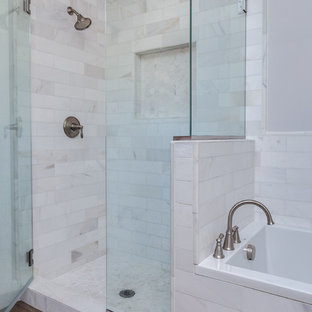 Example of a mid-sized minimalist master white tile and porcelain tile bathroom design in Denver with white cabinets, white walls and marble countertops