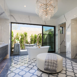 Freestanding bathtub - large contemporary master white tile and marble tile multicolored floor freestanding bathtub idea in Phoenix with flat-panel cabinets, dark wood cabinets, white walls, an undermount sink, white countertops and quartz countertops