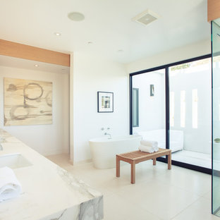 Inspiration for a contemporary white tile bathroom remodel in Los Angeles with an undermount sink and white walls