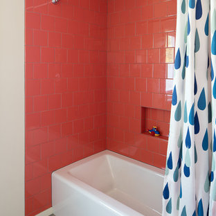 Design ideas for a midcentury family bathroom in Portland with an alcove bath, a shower/bath combination, pink tiles, beige walls, multi-coloured floors and a shower curtain.
