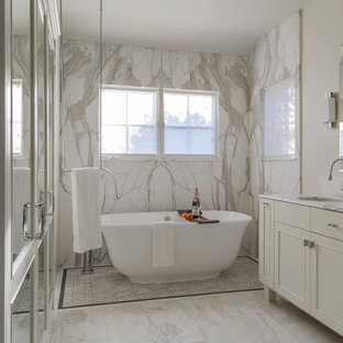 Example of a large transitional master multicolored tile and marble tile marble floor and multicolored floor bathroom design in San Francisco with shaker cabinets, white cabinets, multicolored walls, an undermount sink and marble countertops