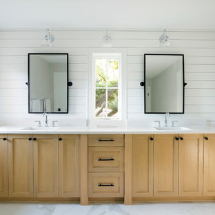 Inspiration for a country master white floor bathroom remodel in Minneapolis with recessed-panel cabinets, light wood cabinets, white walls, an undermount sink and white countertops