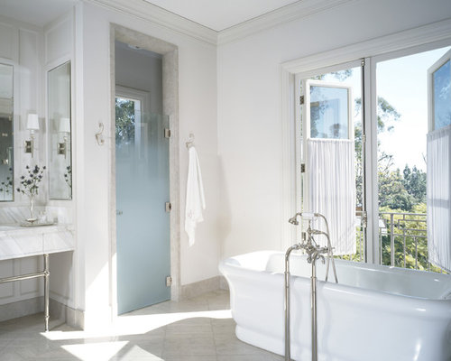 Inspiration For A Transitional Freestanding Bathtub Remodel In Los Angeles  With A Console Sink