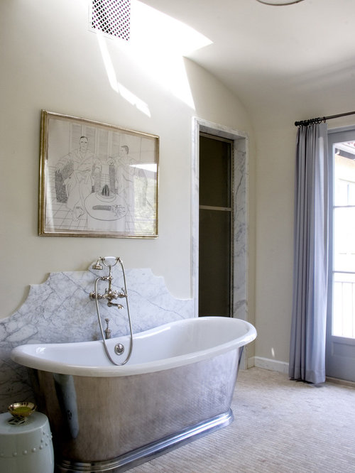 Inspiration For A Mediterranean Bathroom Remodel In Los Angeles With A Freestanding Tub And Marble Tile