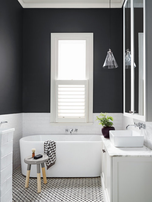 Example Of A Mid Sized Trendy Black And White Tile Freestanding Bathtub Design In Melbourne