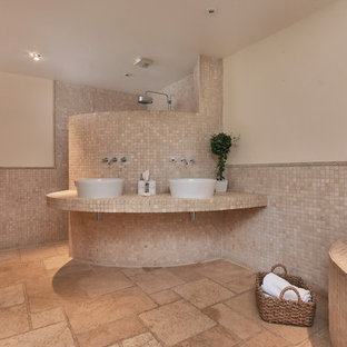 Medium sized mediterranean wet room in Other with a corner bath, beige tiles, mosaic tiles, beige walls, a vessel sink, beige floors and an open shower.
