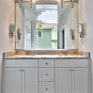 Transitional gray tile bathroom photo in Austin with an undermount sink, shaker cabinets and white cabinets