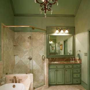 Small tuscan master brown tile and stone tile travertine floor and brown floor bathroom photo in Dallas with raised-panel cabinets, an undermount sink, marble countertops, green cabinets, green walls and a hinged shower door