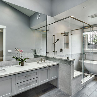 Bathroom - large farmhouse master white tile and porcelain tile limestone floor and gray floor bathroom idea in San Francisco with shaker cabinets, gray cabinets, a one-piece toilet, gray walls, an undermount sink, quartz countertops and a hinged shower door