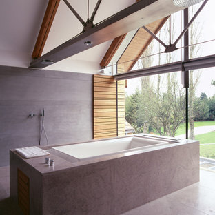 Trendy master gray tile and stone tile bathroom photo in Manchester with white walls