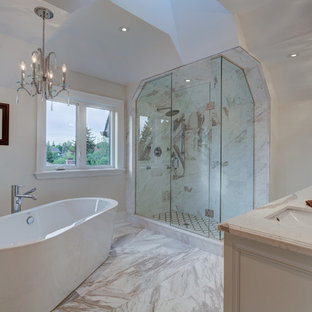 Example of a mid-sized transitional master gray tile and stone tile marble floor bathroom design in Toronto with an undermount sink, furniture-like cabinets, white cabinets, marble countertops, a two-piece toilet and white walls